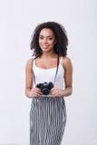 Smiling mulatto woman holding photo camera Royalty Free Stock Image