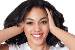 Smiling mulatto woman. Portrait of a smiling mulatto young woman over white background Stock Photos