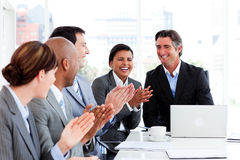 Smiling multi-ethnic business team applauding Stock Photography