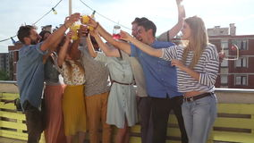 Smiling multi-ethnic friends toasting on the rooftop terrace. Group of smiling multi-ethnic friends toasting on the rooftop terrace stock video footage