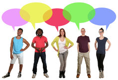 Smiling multi ethnic group of people talking with speech bubble Stock Images