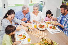 Smiling multi generation family having food Stock Image