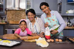 Smiling multi-generation family preparing food in kitchen Royalty Free Stock Photo