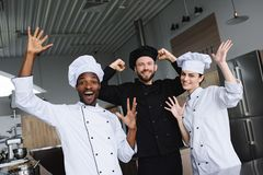 Smiling multicultural chefs having fun. At restaurant kitchen stock images