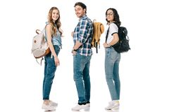 Smiling multicultural students looking at camera. Isolated on white royalty free stock photo
