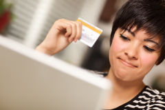 Smiling Multiethnic Woman with Credit Card, Laptop stock photo