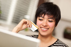 Smiling Multiethnic Woman with Credit Card, Laptop Stock Photos