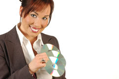 Smiling multimedia business woman. Holding three cd's ,  isolated against a white background Royalty Free Stock Photo