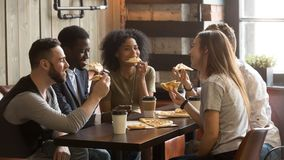 Smiling multiracial colleagues enjoying lunch spending work brea royalty free stock images