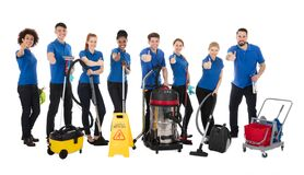 Free Smiling Multiracial Janitors Gesturing Thumbs Up Stock Images - 214020744