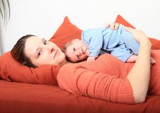Smiling mum with smiling newborn baby girl Stock Images