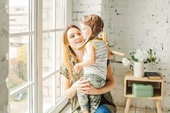 Smiling Mummy and Little Boy Son Hugging. At Home stock images