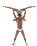 Smiling muscular acrobat holds partner Royalty Free Stock Photography