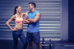 Smiling muscular couple discussing together Stock Photos