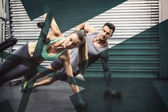 Smiling muscular couple doing side plank royalty free stock images