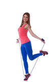 Smiling muscular girl posing with skipping rope Stock Photo