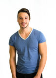 Smiling, muscular male model standing, isolated on white Stock Photos