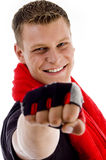 Smiling muscular male with towel showing punch Stock Photos