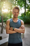 Smiling Muscular Man with Arms Crossing Over Chest Royalty Free Stock Image
