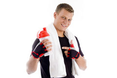 Smiling muscular man pointing at the water bottle Royalty Free Stock Photo