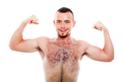 Smiling muscular sports man showing biceps Royalty Free Stock Photography