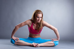 Smiling muscular woman doing fitness exercises Stock Photography