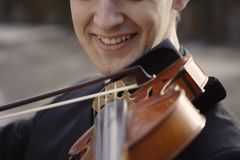 Smiling musician. Image of a young smiling musician stock image