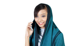 Smiling muslim girl talk on phone Stock Photos