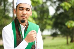 Smiling Muslim Man holding Tasbih Stock Photo