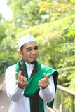 Smiling muslim man show love gesture Stock Photos