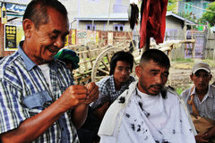 Smiling myanmar barber at work Stock Photos
