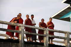 Smiling Myanmar monks on U-Bein bridge Royalty Free Stock Photos
