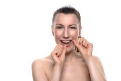 Smiling naked woman using dental floss Royalty Free Stock Photos