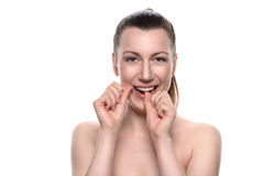Smiling naked woman using dental floss Royalty Free Stock Image
