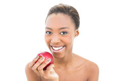 Smiling natural beauty holding red apple Stock Image
