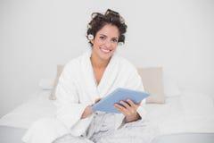 Smiling natural brunette using tablet Stock Photo