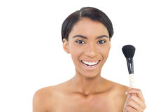 Smiling natural model holding blusher brush Royalty Free Stock Images