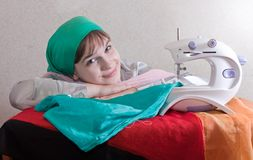 Smiling needlewoman Royalty Free Stock Images