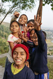 Smiling nepalese kids. With hands reaching forward Royalty Free Stock Images