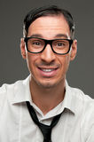 Smiling nerd. Funny portrait of happy nerd with naive expression stock photography