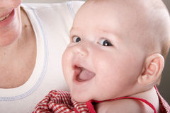Smiling newborn baby Stock Photography