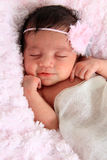Smiling newborn baby Stock Photo