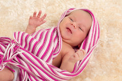 Smiling newborn baby. The first week of the new life Stock Photography