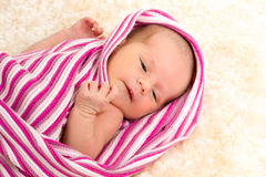 Smiling newborn baby. The first week of the new life Royalty Free Stock Images