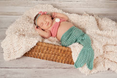 Smiling Newborn Baby Girl in a Mermaid Costume Stock Images