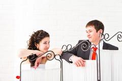 Smiling newlyweds gaze into each others eyes. Horizontal shot Stock Photo