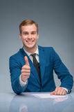 Smiling newscaster showing thumbs up Royalty Free Stock Photo
