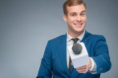 Smiling newsman taking an interview Royalty Free Stock Photos