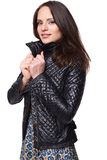 Smiling nice girl in dress with leather jacket Royalty Free Stock Images