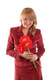 Smiling nice girl with flowers stock image